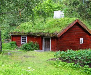 Grass-roofed cottage in Skansen open air museum